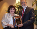 Dean Michael G. Perri presents the PHHP Employee of the Year award to Kimberly Foli.