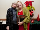 Executive Associate Dean Stephanie Hanson presents the PHHP Employee of the Year award to Susan White.