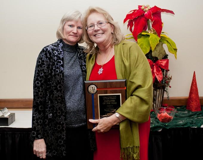 Executive Associate Dean Stephanie Hanson presents the PHHP Employee of the Year award to Susan White.