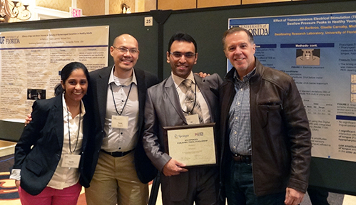 Graduate students Aarthi Madhavan, Isaac Sia and Ali Barikroo with Dr. Michael Crary at the Dysphagia Research Society 2014 meeting