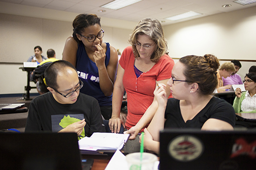 In this biostatistics course, students view online lectures and readings at home and use class time to work on group activities and assignments with instructor Dr. Amy Cantrell on hand to help them work through stumbling blocks.
