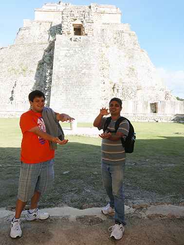 Jacob Ball and Salah Uddin Khan give the Gator chomp at Uxmal, an ancient Mayan city south of Merida in Mexico's Yucatan peninsula.