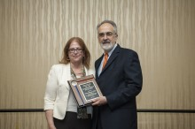 Dr. Michael G. Perri presents the Doctoral Mentor of the Year award to Dr. Dawn Bowers.