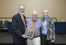 Dr. Perri and Dr. Stephanie Hanson present the Teaching Excellence Award to Dr. Robert Garrigues.