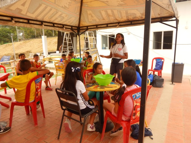 De La Rosa Mateo gives a talk on the importance of handwashing.