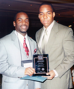 Carlton Inniss and Ajani Dunn took first place at the Everett V. Fox Student Case Analysis and Presentation Competition in 2001.