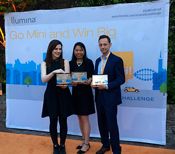 Dr. Mattia Prosperi with Una McVeigh (left), the challenge's third prize winner and Dr. Hongmei Li-Byarlay, the second prize winner, at the awards ceremony in New Orleans.