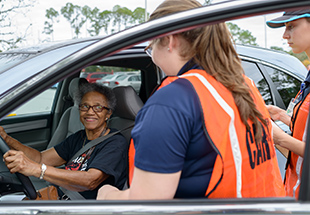 Students talk with a driver at CarFit.
