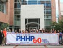 students hold 60th anniversary banner