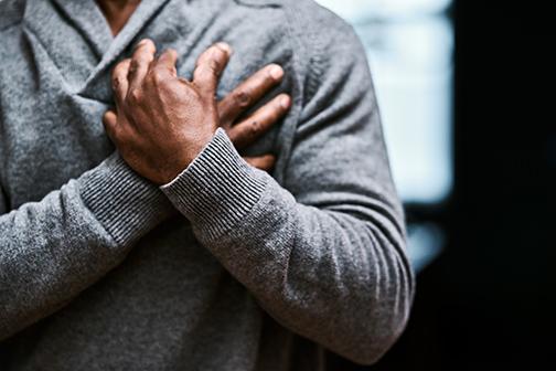man holding chest