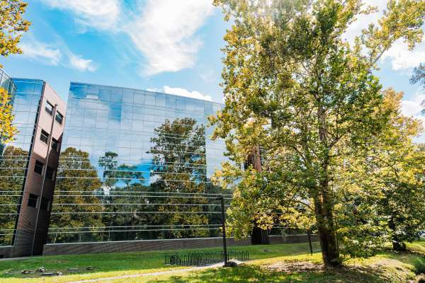 HPNP Complex with trees reflected in windows