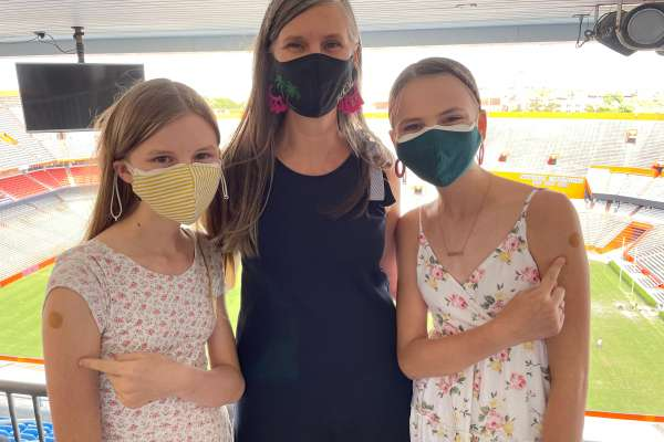 Dr. Kelly Gurka with daughters at vaccination clinic