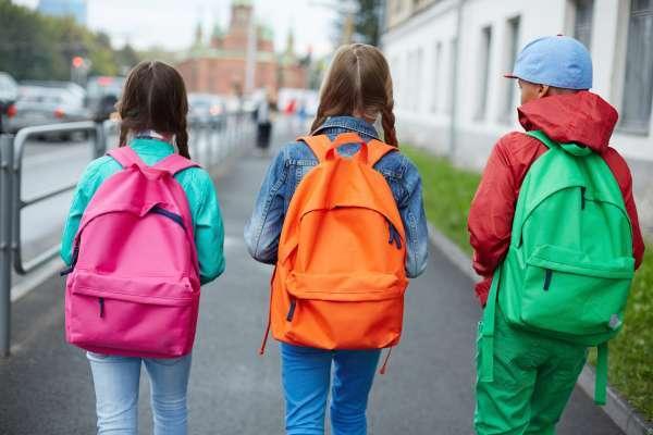 school kids wearing backpacks