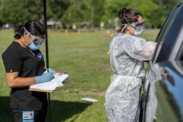 two women providing COVID testing