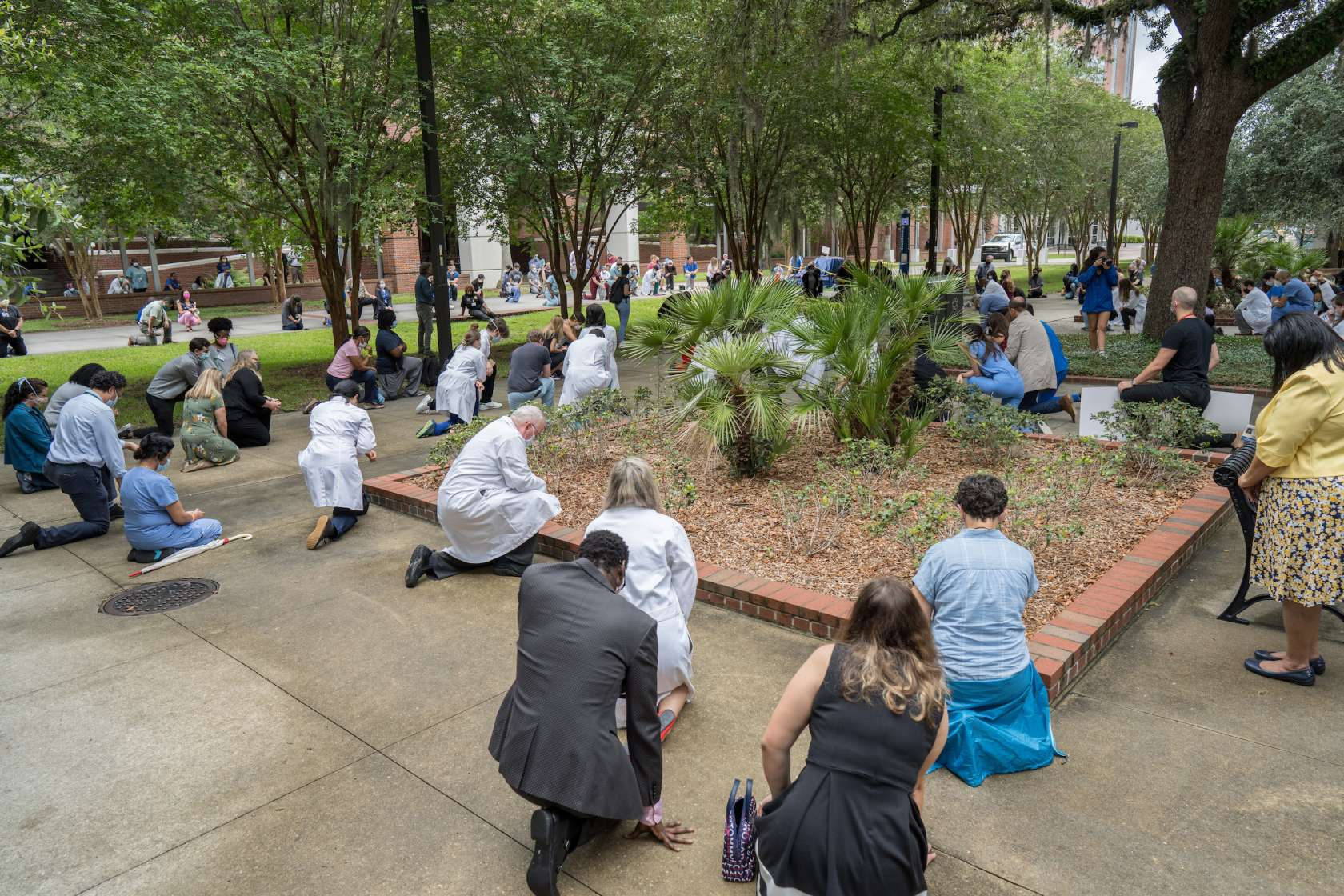 UF Health members join in reflection as part of a White Coats for Black Lives event.