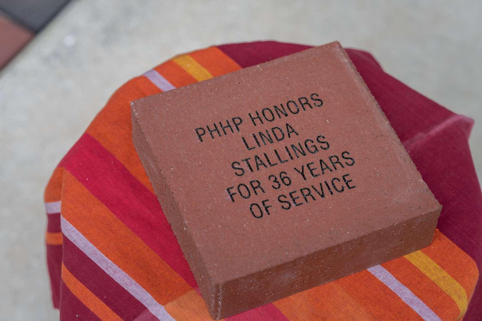 brick engraved with message honoring Linda Stallings